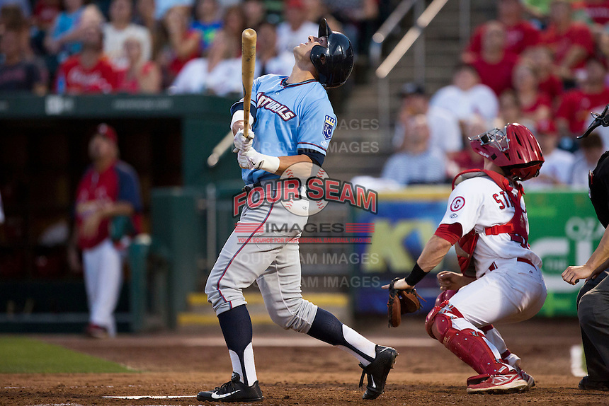 Lane Adams (8) of the Northwest Arkansas Naturals stares straight up after hitting a high pop up during a game against the Springfield Cardinals at Hammons Field on August 23, 2013 in Springfield, Missouri. (David Welker/Four Seam Images)