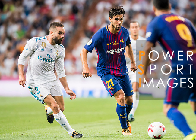 Andre Filipe Tavares Gomes (r)of FC Barcelona is followed by  Daniel Carvajal Ramos of Real Madrid during their Supercopa de Espana Final 2nd Leg match between Real Madrid and FC Barcelona at the Estadio Santiago Bernabeu on 16 August 2017 in Madrid, Spain. Photo by Diego Gonzalez Souto / Power Sport Images