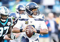 CHARLOTTE, NC - DECEMBER 15: Russell Wilson #3 of the Seattle Seahawks runs with the ball during a game between Seattle Seahawks and Carolina Panthers at Bank of America Stadium on December 15, 2019 in Charlotte, North Carolina.