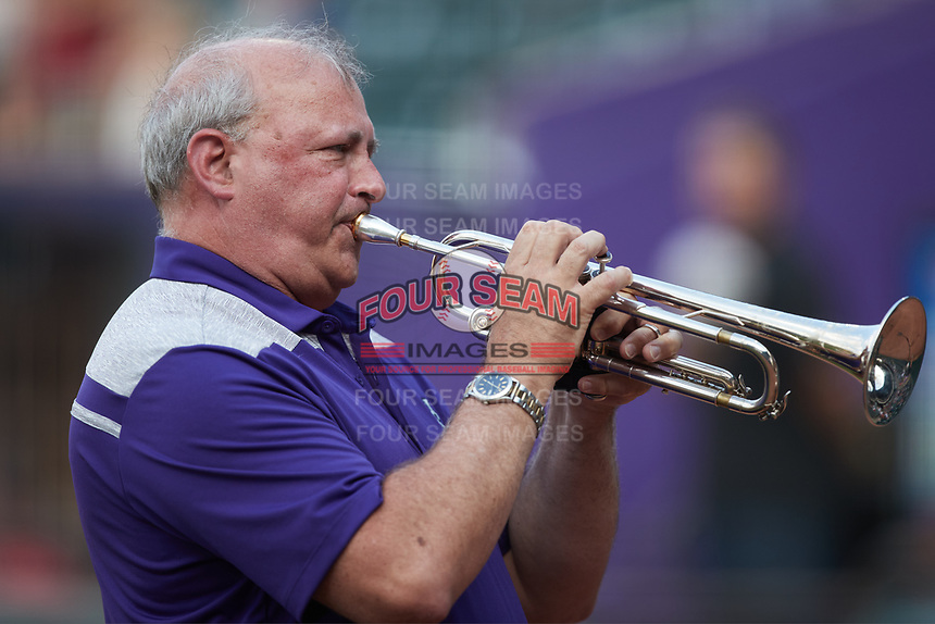 Wake Forest University Director of Bands Kevin Bowen plays the National Anthem on his trumpet prior to the baseball game between the Hickory Crawdads and the Winston-Salem Dash at Truist Stadium on July 6, 2021, in Winston-Salem, North Carolina. (Brian Westerholt/Four Seam Images)