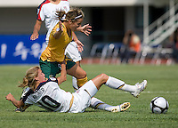 USWNT midfielder (10) Aly Wagner tackles the ball away from Australia's (13) Amy Chapman during the Peace Queen Cup  in Suwon, South Korea.  The U.S. defeated Australia, 2-1, at the Suwon Sports Complex.