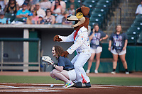 Tennessee Smokies Rally Crew member Emily Workman catches a ceremonial first pitch as mascot Homer Hound, dressed as Elvis Presley, looks on prior to the game against the Chattanooga Lookouts at Smokies Stadium on July 31, 2021, in Kodak, Tennessee. (Brian Westerholt/Four Seam Images)