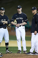 Shane Muntz (11) of the Wake Forest Demon Deacons waits for the new pitcher to arrive on the mound during the game against the Notre Dame Fighting Irish at David F. Couch Ballpark on March 10, 2019 in  Winston-Salem, North Carolina. The Fighting Irish defeated the Demon Deacons 8-7 in 10 innings in game two of a double-header. (Brian Westerholt/Four Seam Images)