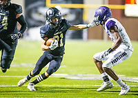 Ryan Garrett (74) leading the way for Sean Anderson (21) of  Bentonville against Fayetteville  at Tigers Stadium, Bentonville, Arkansas on Friday, October 16, 2020 / Special to NWA Democrat-Gazette/ David Beach