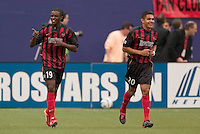 MetroStars' Fabian Taylor celebrates scoring his second goal of the game with teammate Amado Guevara. D. C. United was defeated by the NY/NJ MetroStars 3 to 2 during the MetroStars home opener at Giant's Stadium, East Rutherford, NJ, on April 17, 2004.