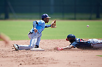 Tampa Bay Rays Gionti Turner (80) stretches for a throw as Jeremy Fernandez (27) slides in during a Minor League Extended Spring Training game against the Atlanta Braves on April 15, 2019 at CoolToday Park Training Complex in North Port, Florida.  (Mike Janes/Four Seam Images)