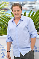 CANNES, FRANCE. July 11, 2021: Benoit Magimel at the photocall for Peaceful (De Son Vivant) at the 74th Festival de Cannes.<br /> Picture: Paul Smith / Featureflash