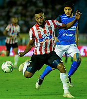 BARRANQUILLA-COLOMBIA, 16-02-2020: Miguel Ángel Borja de Atlético Junior y Andrés Correa de Once Caldas disputan el balón, durante partido entre Atlético Junior y Once Caldas, de la fecha 5 por la Liga BetPlay DIMAYOR I 2020, jugado en el estadio Metropolitano Roberto MelŽndez de la ciudad de Barranquilla. / Miguel Angel Borja of Atletico Junior and Andres Correa of Once Caldas battle for the ball, during a match between Atletico Junior and Once Caldas of the 5th date for the BetPlay DIMAYOR I Leguaje 2020 played at the Metropolitano Roberto Melendez Stadium in Barranquilla city. / Photo: VizzorImage / Alfonso Cervantes / Cont.