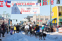 Ray Redington Jr and team leave the ceremonial start line with an Iditarider and handler at 4th Avenue and D street in downtown Anchorage, Alaska on Saturday March 4th during the 2017 Iditarod race. Photo © 2017 by Brendan Smith/SchultzPhoto.com.