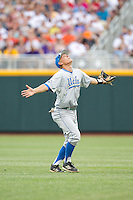 UCLA Bruins shortstop Pat Valaika #10 calls for a fly ball during Game 4 of the 2013 Men's College World Series between the LSU Tigers and UCLA Bruins at TD Ameritrade Park on June 16, 2013 in Omaha, Nebraska. The Bruins defeated the Tigers 2-1. (Brace Hemmelgarn/Four Seam Images)