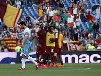 Calcio, Serie A: Lazio vs Roma. Roma, stadio Olimpico, 25 maggio 2015.<br /> Roma's Mapou Yanga-Mbiwa, second from left, celebrates with teammates as Lazio's Marco Parolo, right, leaves the pitch at the end of the Italian Serie A football match between Lazio and Roma at Rome's Olympic stadium, 25 May 2015. Roma won 2-1.<br /> UPDATE IMAGES PRESS/Isabella Bonotto