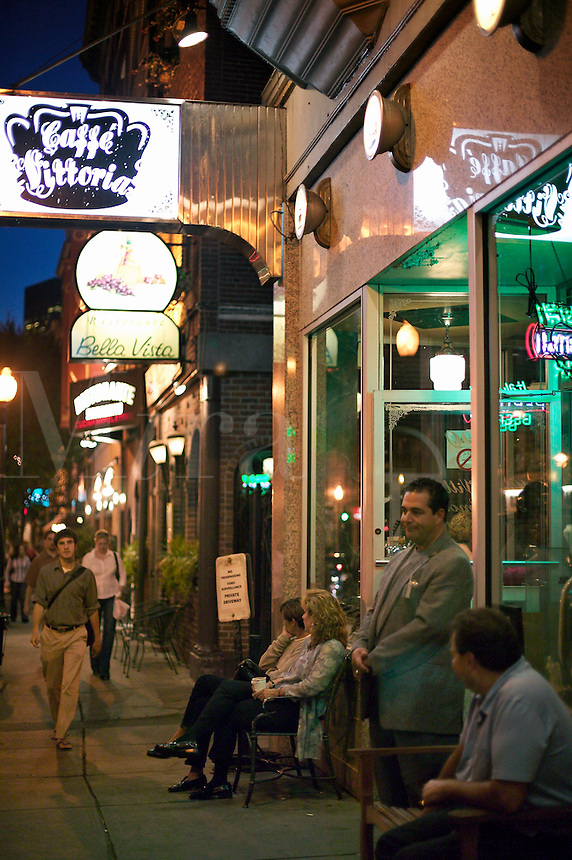 People enjoy evening near Caffe Vittoria on Hanover Street in the Italian District, north end, Boston, M