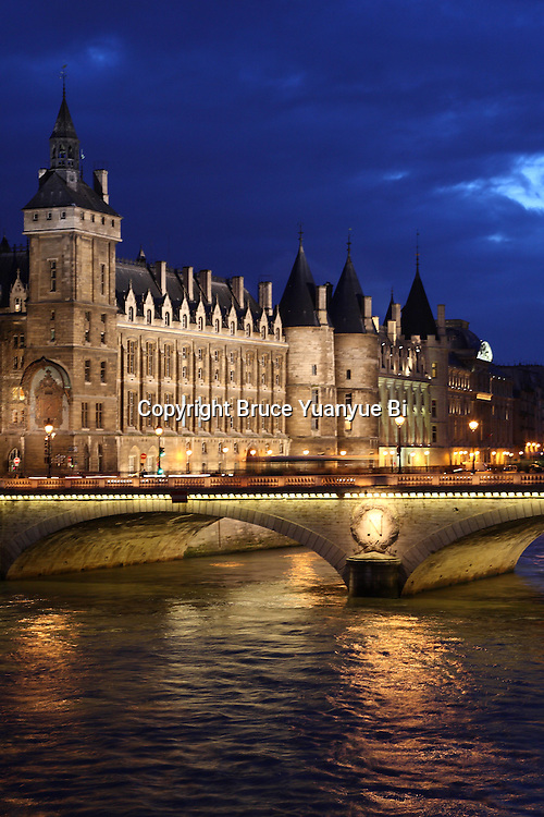 The night view of the Pont au Change bridge over River Seine with the Concergierie in background. Paris. France
