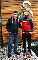 (L-R) The SUn reporter Phil Cadden with Angel Rangel who has been playing for Swansea City FC for ten years, pictured at the club's Fairwood training ground, Swansea, UK Tuesday 10 October 2017
