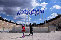 Pictured: A young girl on rollerblades strolls past the Panathinaiko Stadium in Athens, Greece. Wednesday 24 March 2021<br /> Re: Preparations are under way to celebrate the 200 anniversary from the beginning of the Greek revolution of 1821, after an almost 400 year rule by the Ottoman empire, Athens, Greece.