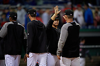 Batavia Muckdogs Andres Sthormes (44) high fives teammates after a NY-Penn League Semifinal Playoff game against the Lowell Spinners on September 4, 2019 at Dwyer Stadium in Batavia, New York.  Batavia defeated Lowell 4-1.  (Mike Janes/Four Seam Images)