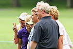 Finnish Minea Blomqvist (far left) posed with fans as a volunteer photorgapher photographs them on the 4th fairway at the LPGA Championship 2011 Sponsored By Wegmans at Locust Hill Country Club in Rochester, New York on June 25, 2011