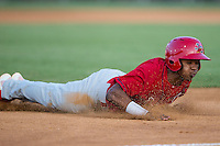 Magneuris Sierra (37) of the Johnson City Cardinals slides head first into third base against the Burlington Royals at Burlington Athletic Park on August 22, 2015 in Burlington, North Carolina.  The Cardinals defeated the Royals 9-3. (Brian Westerholt/Four Seam Images)