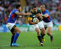 Bryan Habana of South Africa looks for space between Rey Lee-Lo (left) and Paul Perez of Samoa during Match 15 of the Rugby World Cup 2015 between South Africa and Samoa - 26/09/2015 - Villa Park, Birmingham<br /> Mandatory Credit: Rob Munro/Stewart Communications