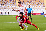 Nguyen Quang Hai of Vietnam (R) gets tripped as he fights for the ball with Vorya Ghafouri of Iran (L) during the AFC Asian Cup UAE 2019 Group D match between Vietnam (VIE) and I.R. Iran (IRN) at Al Nahyan Stadium on 12 January 2019 in Abu Dhabi, United Arab Emirates. Photo by Marcio Rodrigo Machado / Power Sport Images