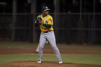 AZL Athletics relief pitcher Jesus Monserratt (52) prepares to deliver a pitch during an Arizona League game against the AZL Giants Black at the San Francisco Giants Training Complex on June 19, 2018 in Scottsdale, Arizona. AZL Athletics defeated AZL Giants Black 8-3. (Zachary Lucy/Four Seam Images)