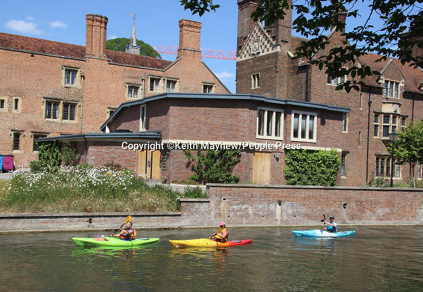 Warm and Sunny day again in Cambridge, as people relax and meet, enjoy anice cream by the River Cam or even take to theriver. The 'lockdown' continues for the Coronavirus (Covid 19) outbreak in the UK. Cambridge, UK on May 30th 2020<br /> <br /> Photo by Keith Mayhew