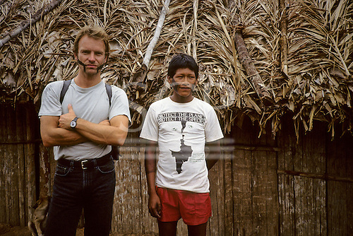 Brazil. Sting with Megranoti-Kayapo Indian wearing Sebastian 'Protect the Planet Protect the Species' t-shirt; Nov 1990.