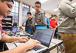 Students receive their PowerUp laptops at Reagan High School, January 12, 2015.