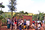 Rwandans meeting on a Saturday morning at month end for national community service day..