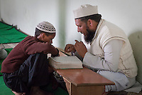 Imam Leads Madrasa Student through his Koranic Reading Lesson, Madrasa Imdadul Uloom, Dehradun, India.