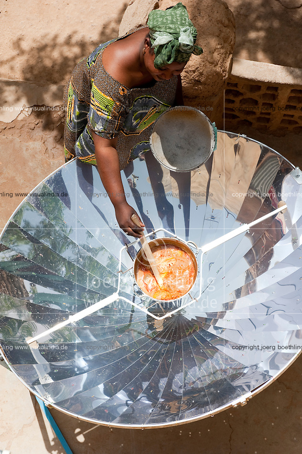 Africa MALI Bandiagara, woman with solar cooker preparing food