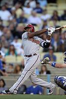 Justin Upton #10 of the Arizona Diamondbacks bats against the Los Angeles Dodgers at Dodger Stadium on May 14, 2012 in Los Angeles,California. Los Angeles defeated Arizona 3-1.(Larry Goren/Four Seam Images)