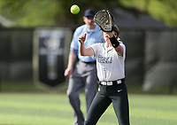 Bentonville first baseman Trista Peterson (7) forces an out, Thursday, April 29, 2021 during a softball game at Bentonville High School in Bentonville. Check out nwaonline.com/210430Daily/ for today's photo gallery. <br /> (NWA Democrat-Gazette/Charlie Kaijo)