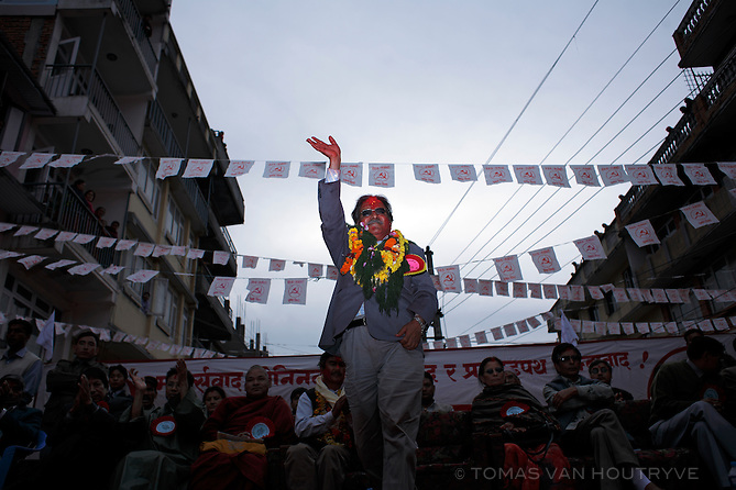 Maoist leader Pushpa Kamal Dahal, who goes by the nom de guerre Prachanda, rises to speak at a campaign rally in Kirtipur on the outskirts of Kathmandu, Nepal on 6 April, 2008. Prachanda lead a final rally before the Constituent Assebly elections scheduled for 10 April. Prachanda was covered with garlands of flowers and red tika powder by his supporters.