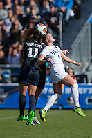 Cary, North Carolina - Sunday December 6, 2015: Raquel Rodriguez (11) of the Penn State Nittany Lions battles for a jump ball with Ashton Miller (4) of the Duke Blue Devils during second half action at the 2015 NCAA Women's College Cup at WakeMed Soccer Park.  The Nittany Lions defeated the Blue Devils 1-0.