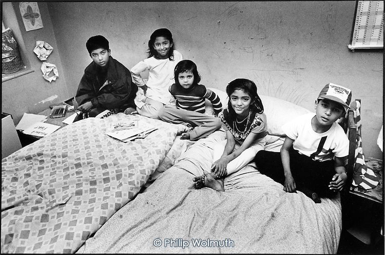 Five Bangladeshi children in the room they share in a two-bedroom council flat in Levita House, King's Cross.