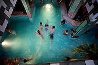 .An indoor swimming pool in El Alto.Just 25 years ago it was a small group of houses around La Paz  airport, at an altitude of 12,000 feet. Now El Alto city  has  nearly one million people, surpassing even the capital of Bolivia, and it is the city of Latin America that grew faster .<br /> It is also a paradigmatic city of the tubles and traumas of the country. There got refugee thousands of miners that lost  their jobs in 90 ´s after the privatization and closure of many mines. The peasants expelled by the lack of land or low prices for their production. Also many who did not want to live in regions where coca  growers and the Army  faced with violence.<br /> In short, anyone who did not have anything at all and was looking for a place to survive ended up in El Alto.<br /> Today is an amazing city. Not only for its size. Also by showing how its inhabitants,the poorest of the poor in one of the poorest countries in Latin America, managed to get into society, to get some economic development, to replace their firs  cardboard houses with  new ones made with bricks ,  to trace its streets,  to raise their clubs, churches and schools for their children.