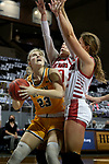 SIOUX FALLS, SD - MARCH 8: Olivia Skibiel #23 of the North Dakota State Bison looks to the basket between a double team from the South Dakota Coyotes during the Summit League Basketball Tournament at the Sanford Pentagon in Sioux Falls, SD. (Photo by Dave Eggen/Inertia)