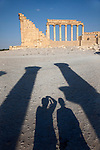 Tourists photograph some of the many Roman colonnades inside the Temple of Bel the largest of the ruins on the site.