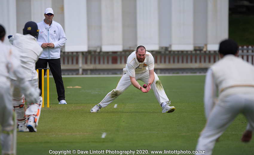 Iain McPeake fields off his own bowling during day one of the Plunket Shield match between the Wellington Firebirds and Otago at Basin Reserve in Wellington, New Zealand on Thursday, 5 November 2020. Photo: Dave Lintott / lintottphoto.co.nz