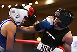 Army's Alan Alvarado, right, defeats UC Davis' Mac Pham during a National Collegiate Boxing Association bout at the El Dorado Casino in Reno, Nev. on Friday, Feb. 5, 2016. <br /> Photo by Cathleen Allison