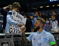 KANSAS CITY, KS - MAY 29: Johnny Russell #7 of Sporting KC stops by to with a happy young man happy 12th birthday during a game between Houston Dynamo and Sporting Kansas City at Children's Mercy Park on May 29, 2021 in Kansas City, Kansas.
