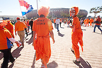 Two of five Denmark supporters wear costumes while entering at Soccer City in Johannesburg, South Africa on Monday, June 14, 2010 before the Netherlands and Denmarks first round FIFA World Cup match.
