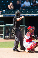 Home plate umpire Brennan Miller calls a strike behind catcher Jeremy Martinez (4) during an Arizona Fall League game between the Surprise Saguaros and the Peoria Javelinas at Surprise Stadium on October 17, 2018 in Surprise, Arizona. (Zachary Lucy/Four Seam Images)
