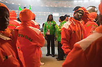 A stadium volunteer (center) tries to help Ivory Coast supporters sit together after they were not able to find seats to sit together at Soccer City during the FIFA World Cup first round match between Ivory Coast and Brazil at Soccer City in Johannesburg, South Africa on Sunday, June 20, 2010.  The fans did not buy group seats to sit together, but rather individual seats and they were situated all around the stadium.  After trying to find seats together with security, they were unable to and ended up having to split apart and find their own seats.