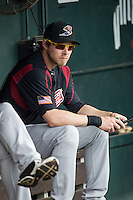 Sacramento River Cats outfielder Josh Reddick (26) sits in the dugout before the Pacific Coast League baseball game against the Round Rock Express on June 19, 2014 at the Dell Diamond in Round Rock, Texas. The Express defeated the River Cats 7-1. (Andrew Woolley/Four Seam Images)
