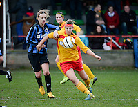 20140104 - AALTER , BELGIUM : Massenhoven's Jolien Baeten (r) pictured with Brugge's Ellen Lagrange (l) during the female soccer match between Club Brugge Vrouwen and Massenhoven VC , of the 1/8 final matchday in the Belgian Women Cup competition. Saturday 4 January 2014 . PHOTO DAVID CATRY