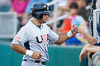 Pedro Alvarez #24 of Team USA fist bumps a teammate after scoring a run in the first inning against Team Canada at the USA Baseball National Training Center, September 4, 2009 in Cary, North Carolina.  (Photo by Brian Westerholt / Four Seam Images)
