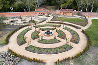 BNPS.co.uk (01202) 558833. <br /> Pic: CorinMesser/BNPS<br /> <br /> Pictured: The central rose garden taking shape. <br /> <br /> Carey Secret Garden.<br /> <br /> The new owners of a historic country estate have discovered an overgrown secret garden that had lain untouched and forgotten for more than 40 years.<br /> Simon Constantine was astounded when he and his children went off exploring the grounds of Carey House near Wareham, Dorset, and found the 'lost' walled garden behind a padlocked gate.<br /> The 3.5 acre plot was built 140 years ago and would have at one stage served both the estate and the wider community with fresh fruit, vegetables and cut flowers back in the day.