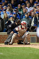Umpire Tony Randazzo and Cleveland Indians catcher Roberto Perez Perez (55) in the fourth inning during Game 5 of the Major League Baseball World Series against the Chicago Cubs on October 30, 2016 at Wrigley Field in Chicago, Illinois.  (Mike Janes/Four Seam Images)